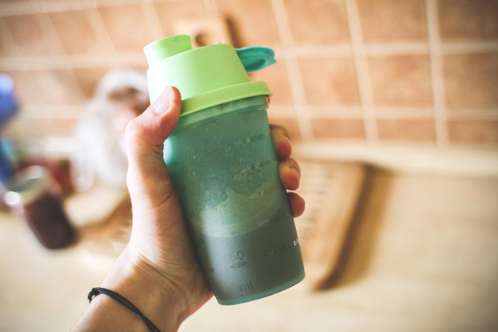 man-holding-fitness-gainerprotein-shake-picjumbo-com